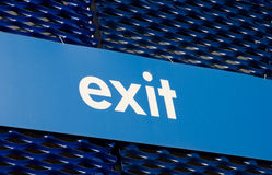 Exit sign on blue background. Showroom Stock Image
