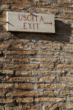 Exit sign on a brick wall Stock Photos