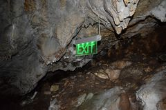 Exit sign in a cave. Stock Image