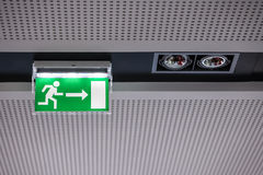Exit sign on the ceiling. Green exit sign on the ceiling Royalty Free Stock Photography