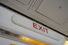 Exit sign in a commercial airplane Royalty Free Stock Image