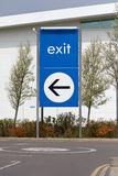 Exit sign with direction arrow Stock Photo