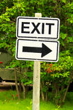 A exit sign with a directional arrow Stock Photos