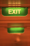 Exit sign. Green sign Exit is on the ceiling of the corridor of a a cruise liner. The signboard is lit, could be the fire alarm. It's easy to get lost in the stock images