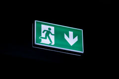 Exit sign hanging on ceiling in dark Royalty Free Stock Images