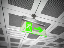 Exit sign hanging on suspended ceiling Royalty Free Stock Images
