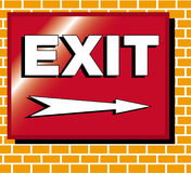 Exit sign illustration. An image of an exit sign with an arrow pointing right. The sign which is red is on a brick wall and the letters and arrow are white with Royalty Free Stock Photo