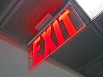 Exit sign inside of silver surface, security. Exit sign inside of silver surface, modern security details Stock Photos