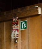 Exit sign on old wooden door Stock Photo