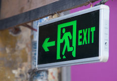 Exit sign points the way out Stock Image