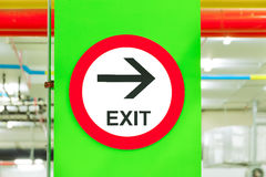 EXIT Sign Post In Parking Garage Building. Stock Photo
