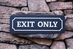 Exit Sign On Stone Wall Stock Photos