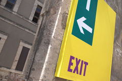 Exit sign. On a wall Stock Photos