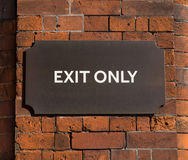 EXIT ONLY sign. An Exit Only Sign on a wall Stock Images