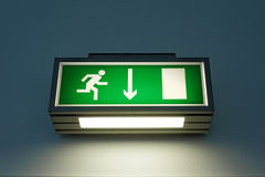 Exit sign on the wall Royalty Free Stock Photography