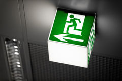 Exit sign on the wall. In a building Stock Photo