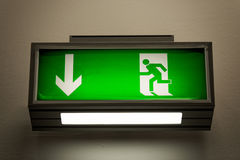 Exit sign on the wall. In a building Stock Images