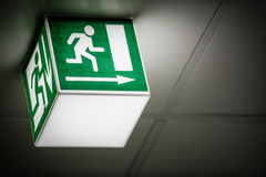 Exit sign on the wall. In a building Stock Photos
