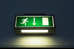 Exit sign on the wall. In a building Royalty Free Stock Photography