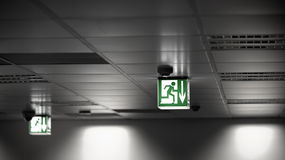Exit sign on the wall. In a building Stock Photography