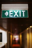 Exit sign on the wall. Exit sign on a wall in hotel corridor Stock Images