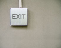 Exit on silver sign on concrete wall. Modern building sign concept Stock Images