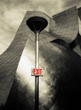 Exit Stage Right. An exit sign on a light post Royalty Free Stock Photography
