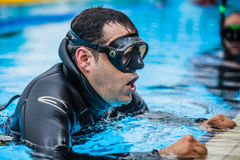 Exit of Static Apnea which will be followed with Official Protoc. Montreal, CANADA - May 30th, 2015. Official AIDA Freediving Pool Competition Taking place in Stock Photo