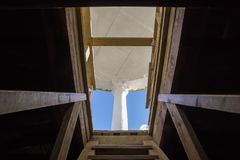 Exit to a roof on a wooden ladder in sunny day Stock Photo