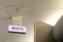 Exit and toilet sign on board airplane Royalty Free Stock Photos