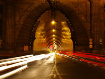 Exit of a tunnel with cars Stock Images