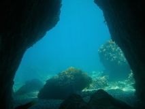Exit of an underwater cave in Mediterranean sea Stock Images