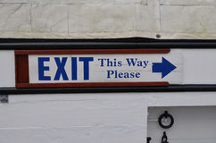 Exit this way please sign. Stock Photos