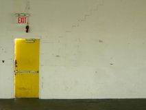 Exit yellow door Stock Image