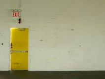 Exit yellow door Stock Image