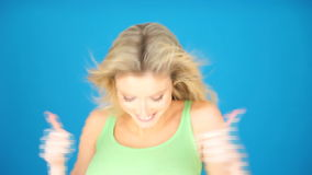 Exited blonde woman on blue Stock Photo