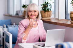 Exited businesswoman having a glass of water Stock Photography