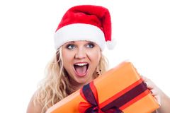 Exited Christmas woman. With present, isolated on white background Stock Photography