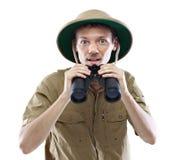 Exited explorer holding binoculars Stock Image