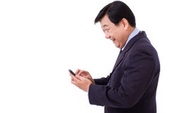 Exited, happy businessman with smartphone Stock Photos