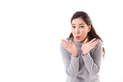Exited, happy, smiling, joyful woman wearing grey sweater. Showing her palm to you, with text space Stock Photo