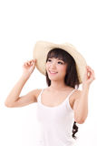 Exited, happy, smiling woman looking up, hand holding hat stock photo