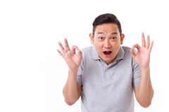 Exited man giving ok hand sign gesture Royalty Free Stock Photos
