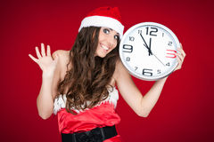 Exited santa woman with clock - new year Stock Image