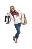 Exited shopping woman carrying bags Royalty Free Stock Photos