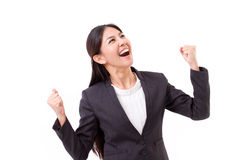 Exited, successful business woman looking up Stock Photography