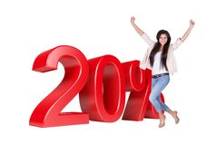 Exited Woman Jumping In Front Of 20% Sale Discount. Isolated On White Background Stock Images
