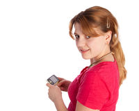 Exited young girl holding a music player Stock Photo