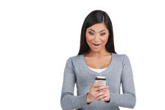 Exited young Indian girl looking at her cell phone. Stock Image