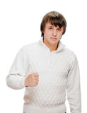 Exited young man kicks air clenched fists arm Stock Photography